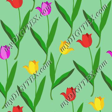 Colorful tulips on green